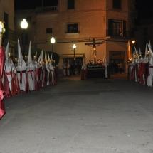 La Confraria amb el Pas del Sant Crist al fons. Processó Setmana Santa de Felanitx de 2010